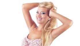 美妙的白肤金发的妇女纵向  库存照片