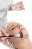 美容院,面部面具申请 免版税库存图片