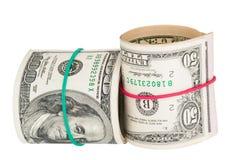 美金卷起与rubberband 库存照片