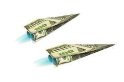 从美金的喷气机origami在被隔绝的背景的球 库存图片