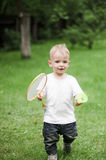 羽毛球男孩使用的一点 库存图片