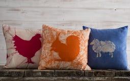 羽绒枕头设置与牲口题材 图库摄影