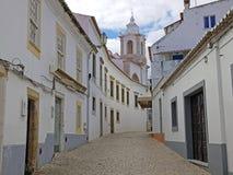 老中世纪街道在有玛丽亚教会的拉各斯Algarv的 免版税图库摄影