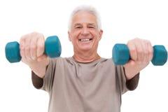 老人举的手重量 免版税图库摄影