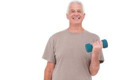 老人举的手重量 免版税库存照片