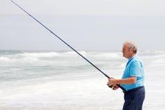 老人捕鱼 免版税库存照片