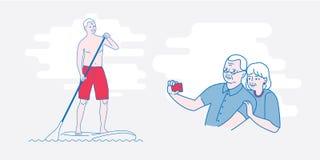 老人站立用浆划 免版税图库摄影