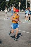 老人赛跑者竞争 库存图片