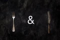 老农庄刀子和叉子在具体顶视图 库存照片