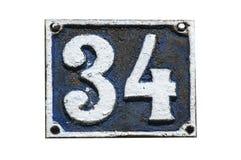老减速火箭的生铁牌照编号34 免版税库存照片