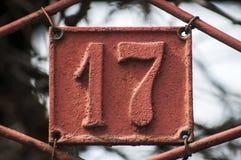 老减速火箭的生铁牌照编号17 免版税库存照片