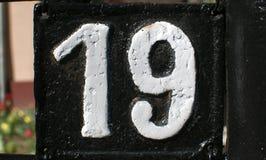 老减速火箭的生铁牌照编号19 免版税库存图片