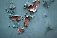 老削皮蓝色墙壁 免版税库存照片