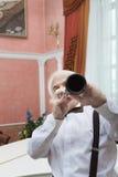 老化音乐家播放单簧管 库存图片