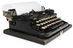 老古色古香的葡萄酒便携式的打字机,有p一个空白纸的  免版税库存照片