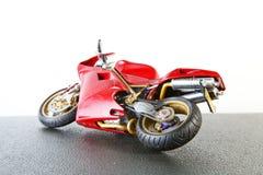 老和肮脏的摩托车塑料模型 库存图片