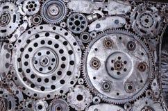 老和肮脏的金属轮子齿轮焊接背景 库存图片