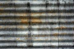 老土气锌板料墙壁纹理 难看的东西生锈的墙壁背景 免版税图库摄影