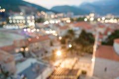 老城市被弄脏的背景与晚上点燃 免版税图库摄影