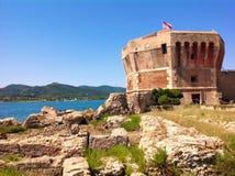 老塔在费拉约港,意大利 免版税图库摄影