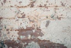 老墙壁有粉碎的膏药纹理背景 免版税库存图片