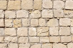 老墙壁由自然石头制成 库存图片