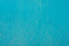 老墙壁的纹理,绘在蓝色油漆 免版税图库摄影