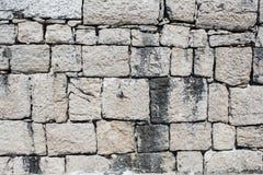 老墙壁纹理从被摆正的石砖的 免版税库存图片