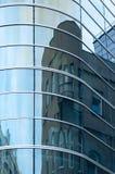 老大厦的反射在新的玻璃的 库存照片