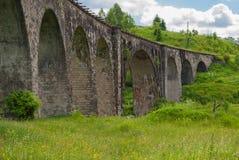 老奥地利石铁路桥高架桥在乌克兰 免版税库存图片