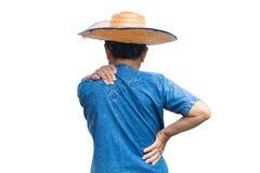 老妇人在白色背景的农夫腰疼 免版税库存照片