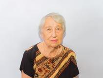 老妇人面孔画象,变老的处理概念 库存图片