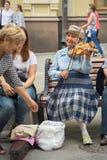 老妇人音乐家 库存图片