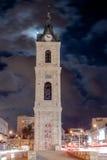 老尖沙咀钟楼在晚上在老城市Yafo,以色列 它` s石灰石钟楼在1903年建造的尊敬其中一个Th的最后苏丹 库存图片