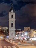 老尖沙咀钟楼在晚上在老城市Yafo,以色列 它` s石灰石钟楼在1903年建造的尊敬其中一个Th的最后苏丹 免版税库存图片
