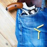 老左轮手枪nagant在口袋 免版税库存图片
