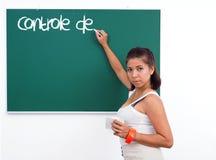 老师在绿色委员会写法国词 免版税库存图片