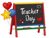 老师天、心脏和气球,孩子的黑板画架 免版税库存照片