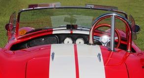 老式样跑车AC眼镜蛇红色仪表板  葡萄酒汽车样式 免版税库存照片
