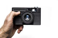 老影片照相机在手上 免版税库存照片