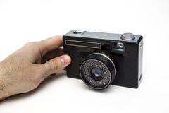 老影片照相机在手上 免版税图库摄影