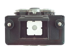 老影片立体声照片照相机和白色墙壁 免版税库存图片