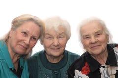 老微笑三名妇女 免版税库存图片