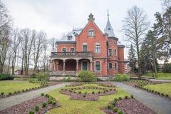 老房子和自然在拉脱维亚,里加在1月 历史buil 库存图片