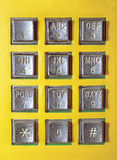 老按钮数字公用电话 免版税库存照片