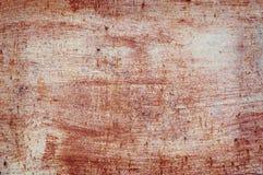 老损坏的破裂的油漆墙壁,难看的东西背景,红颜色 库存照片