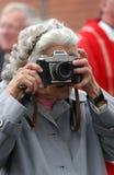 老无固定职业的摄影师 免版税库存图片