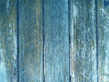 老木头和板条围住蓝色背景的纹理 库存图片