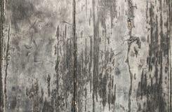 老木头纹理与深灰颜色破裂的油漆的  免版税库存照片