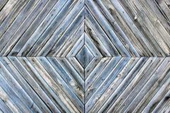 老木板的一个菱形样式,灰色蓝色背景纹理 免版税库存照片